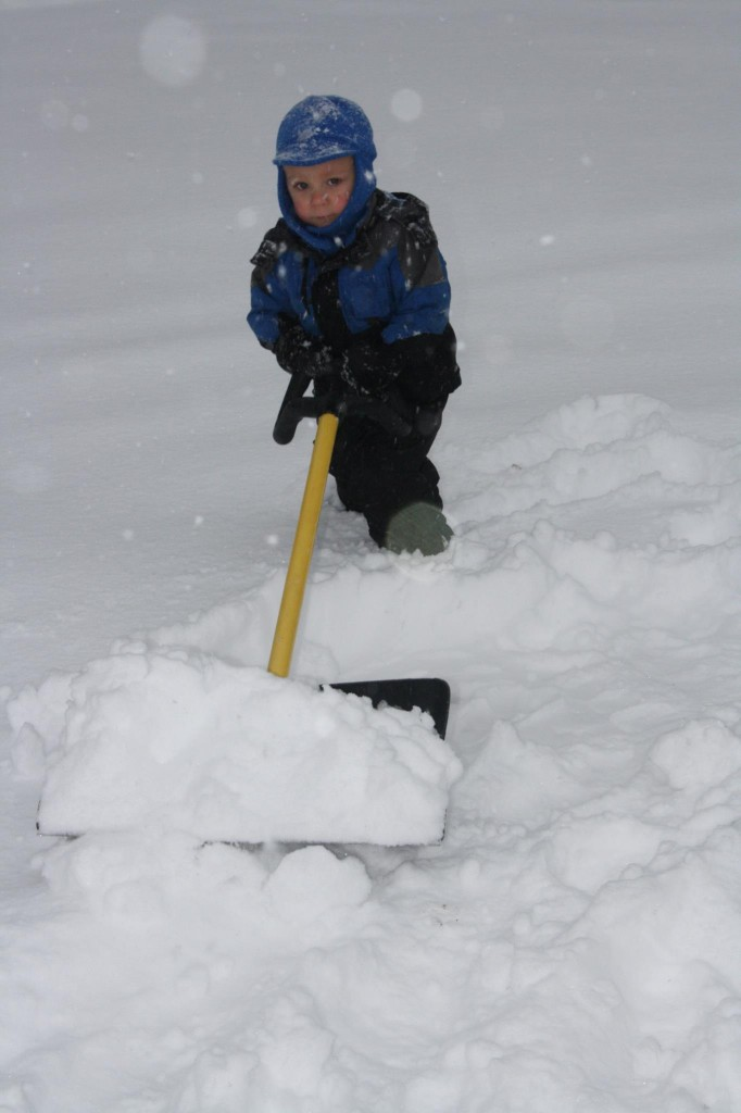 Aiden Wilson, 2 1/2, tries his hand at a time-honored Maine tradition -- shoveling snow -- in Smithfield on Thursday.