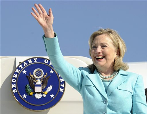 In this June 10, 2011 file photo, Secretary of State Hillary Rodham Clinton waves as the arrives at Lusaka International Airport in Lusaka, Zambia. Clinton has been admitted to a New York hospital after the discovery of a blood clot stemming from the concussion she sustained earlier this month. Spokesman Philippe Reines says her doctors discovered the clot during a follow-up exam Sunday, Dec. 30, 2012. (AP Photo/Susan Walsh, Pool)