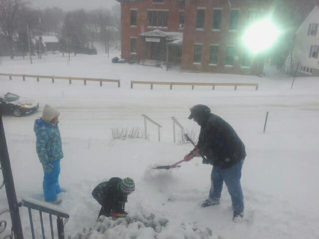 From right, Derek Nickerson, his son, Timmy, and daughter, Macy, get to work clearing the snow in Gardiner on Thursday.
