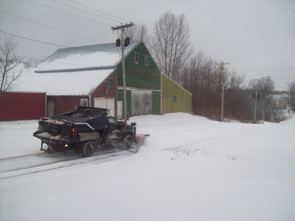 A Skowhegan highway department truck clears Hathaway Street on Thursday.