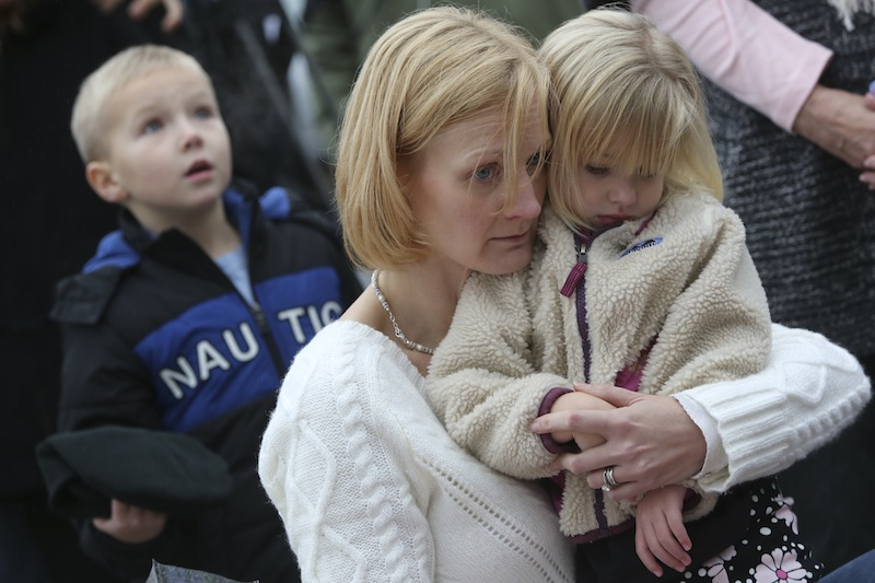 Barbara Wells of Shelton, Conn., holds her daughter Olivia, 3, as she pays her respects Monday, Dec. 17, 2012 at one of the makeshift memorials for the victims of the Sandy Hook Elementary School shooting in Newtown, Conn. (AP Photo/Mary Altaffer)