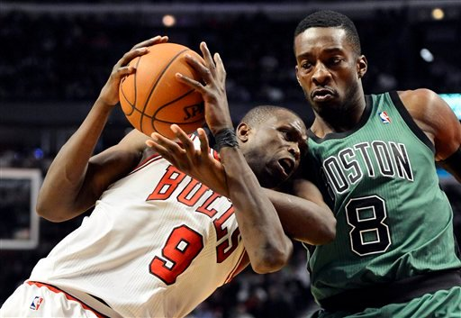 Boston Celtics forward Jeff Green (8) fouls Chicago Bulls forward Luol Deng on Deng's drive to the basket during the third quarter of an NBA basketball game, Tuesday, Dec. 18, 2012 in Chicago. The Bulls won 100-89. (AP Photo/Brian Kersey)