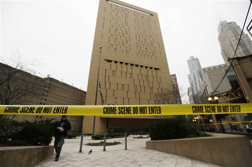 Police tape surrounds the Metropolitan Correctional Center on Tuesday in Chicago.