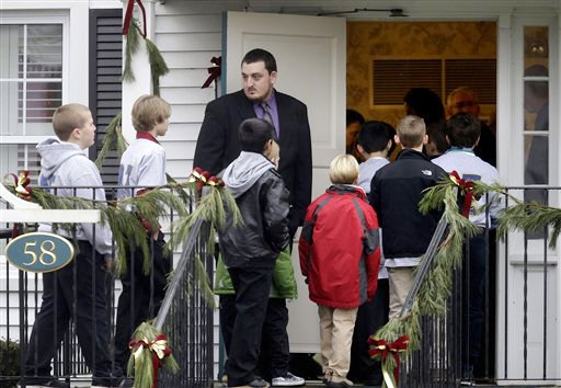 Mourners arrive at the funeral service for 6-year-old Jack Pinto on Monday, in Newtown, Conn. Pinto was one of the 26 people killed when Adam Lanza walked into Sandy Hook Elementary School and opened fire on Friday.
