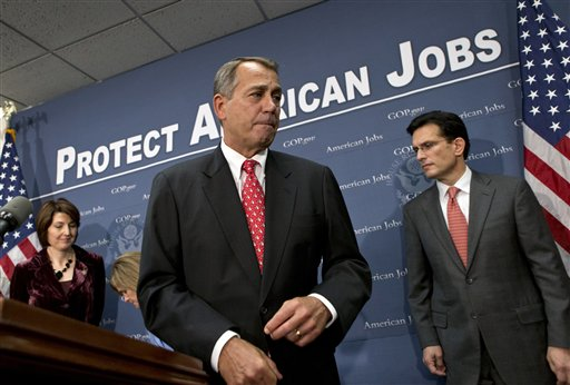 Speaker of the House John Boehner, R-Ohio, is joined by Rep. Cathy McMorris Rodgers, left, and House Majority Leader Eric Cantor, R-Va., right, as they finish a news conference about the fiscal cliff negotiations at the Capitol on Tuesday.
