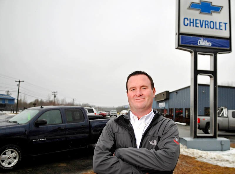 Staff photo by Andy Molloy ON A ROLL: Steve Shuman's, whose family operates Charlie's Motor Mall, is the new president of Charlie's Chevrolet, formerly Bob Barrow's Chevrolet, in Winthrop. The Shuman family bought the business Tuesday.