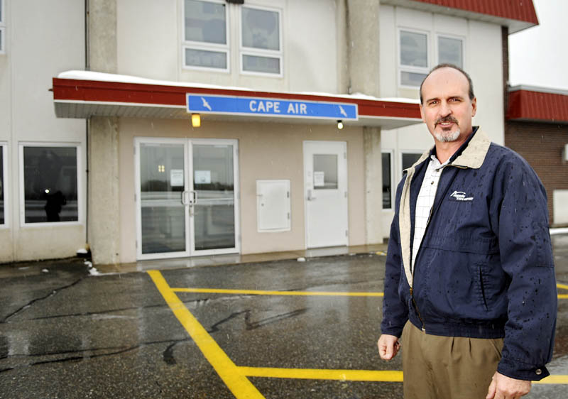 Staff photo by Andy Molloy RUNWAY: Augusta State Airport manager John Guimond on the tarmac Tuesday. The city may not renew a long standing lease with the State of Maine but will continue to operate the facility that serves Cape Air and private planes.