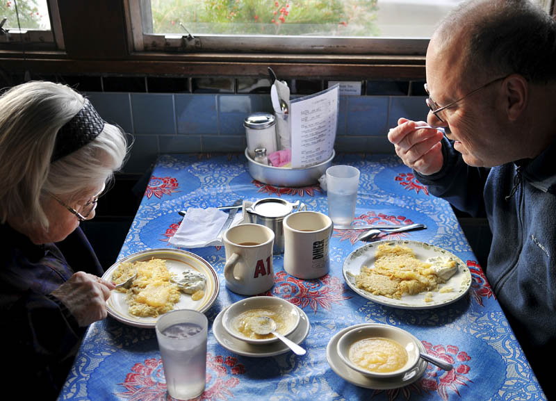 Martin Weiss and his mother, Miriam, sample latkes on Sunday at the A1 Diner in Gardiner. A special menu was served at the restaurant, which celebrated the arrival of Hanukkah, including the potato pancakes that are served with a side of applesauce.