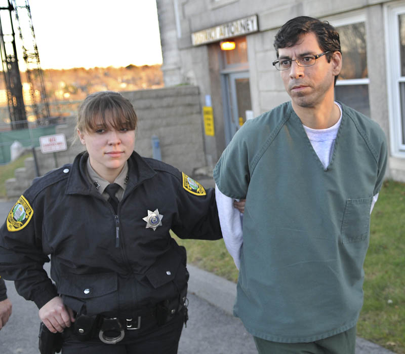 Michael Young, 41, is escorted to jail Thursday, after pleading guilty to manslaughter at Kennebec County Superior Court for the June 2011 stabbing of his domestic partner, David Cox,in Augusta.