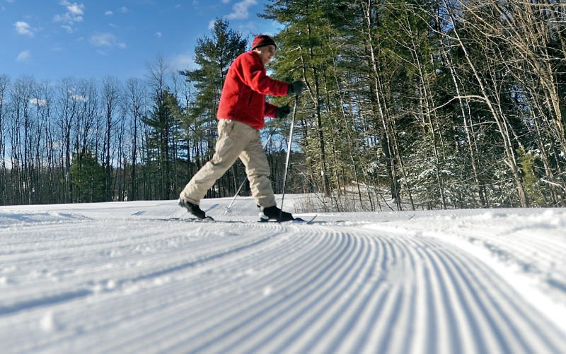 Steve Knight, of Oakland, skis down a groomed cross country ski trail at Quarry Road Recreation Area in Waterville on Friday. Knight was pleased with the fresh snow and noted he's excited at the prospect of snowmaking machines being installed to help keep the trails useable through warmer and dryer weather.
