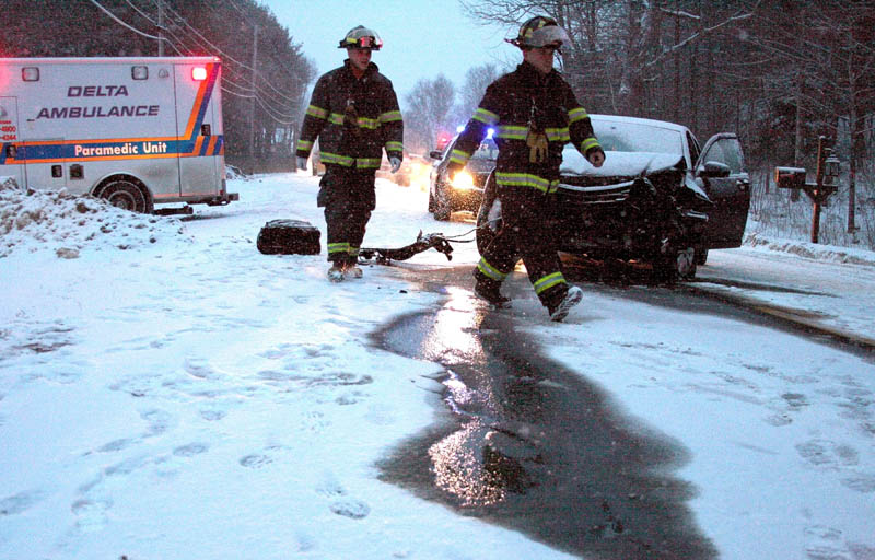 Firefighters from Winslow respond to a two-vehicle crash that closed Route 32 for about an hour Saturday afternoon. One person sustained minor injuries in the weather-related crash.