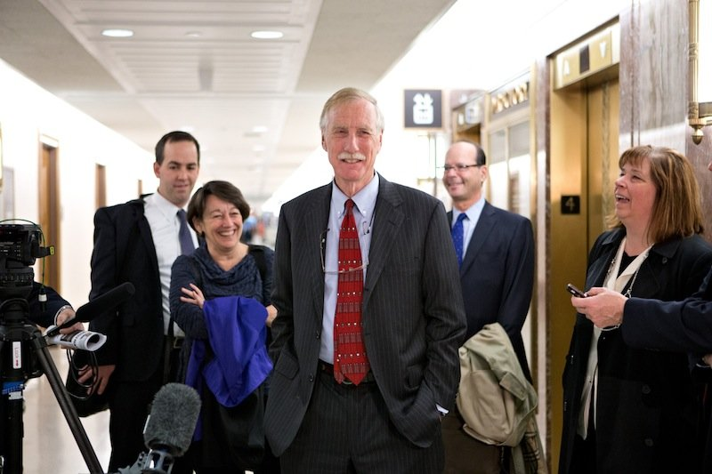 Sen.-elect Angus King, I-Maine, center, the former governor of Maine, arrives on Capitol Hill in Washington, Tuesday, Nov. 13,2012. (AP Photo/J. Scott Applewhite)