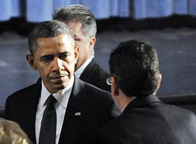 President Barack Obama greets Gov. Dannel Malloy during his arrival at the start of an interfaith vigil for the victims of the Sandy Hook Elementary School shooting on Sunday, Dec. 16, 2012 at Newtown High School in Newtown, Conn. Five days before the U.S. goes over the