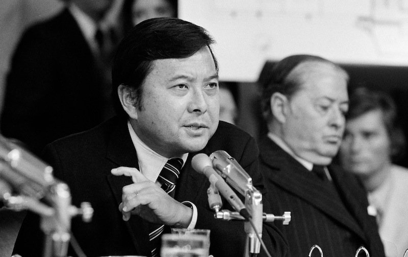 In this May 19, 1973 file photo, Sen. Daniel K. Inouye, D-Hawaii, a member of the Watergate investigating committee, questions witness James McCord during the hearing on Capitol Hill in Washington, as John M. Montoya, Democrat of New Mexico, is at right. Inouye, the influential Democrat who broke racial barriers on Capitol Hill and played key roles in congressional investigations of the Watergate and Iran-Contra scandals, died of respiratory complications, Monday, Dec. 17, 2012, according to his office. He was 88. (AP Photo/File) close;up;crime;hearing;investigations;listening;politician;politics;prominent;Japanese;Americans;senator;Watergate;scandal