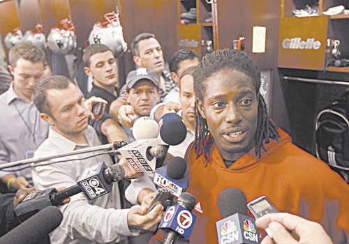 BACK IN THE LINEUP: New England Patriots wide receiver Deion Branch responds to a reporter's question in front of his locker Thursday in Foxborough, Mass. The Patriots host the San Francisco 49ers on Sunday.