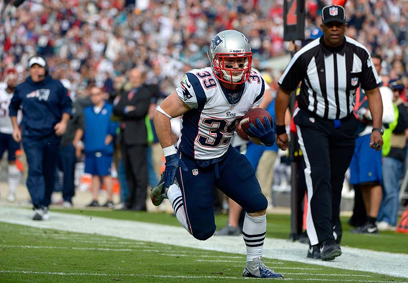 Patriots running back Danny Woodhead runs for a touchdown against the Jacksonville Jaguars on a 14-yard touchdown pass play at the end of the first half Sunday at Jacksonville, Fla. NFLACTION12;