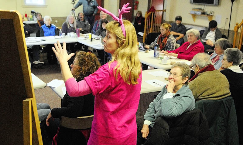 Lisa Savage, standing, facilitates a meeting of activists held to discuss the fiscal cliff on Saturday in Augusta.