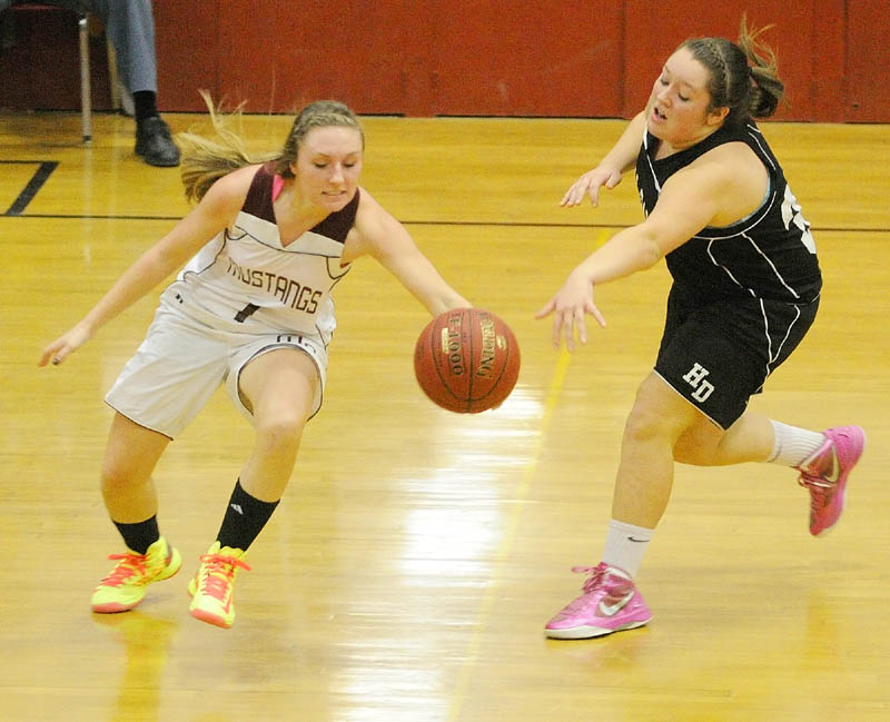 Monmouth senior guard Danielle Bumann, left, tries to regain control of the ball after Hall-Dale freshman forward Molly French knocked it away from her Thursday at Monmouth Academy. The Mustangs won, 59-55. For local roundup, see C3.