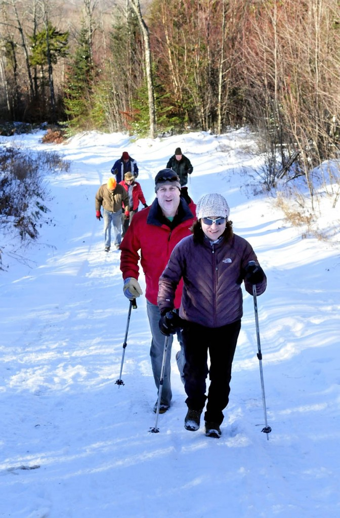 Part of a large group of hikers, including Eva and Jeff Cole, hike toward the Stratton Brook Hut, the fourth building in the Maine Huts and Trails system in Carrabassett Valley, which was formally opened on Wednesday.