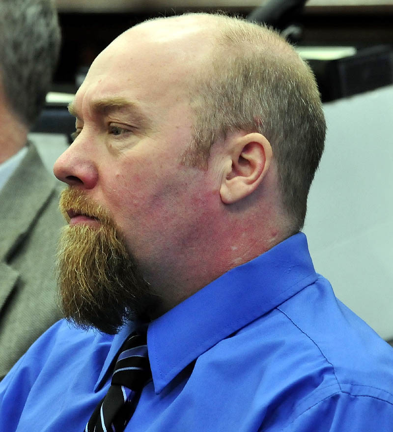 Murder defendent Robert Nelson listens to closing arguments in his trial in the death of Everett Cameron, on Tuesday in Somerset County Superior Court in Skowhegan.