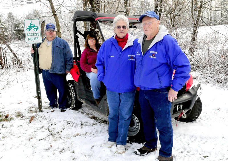 All-terrain vehicle club members are working to gain access to area landowners to connect existing trails for users. From left are Robert Burns, Nora Foster, Vicki Eastman and Jim Moore.