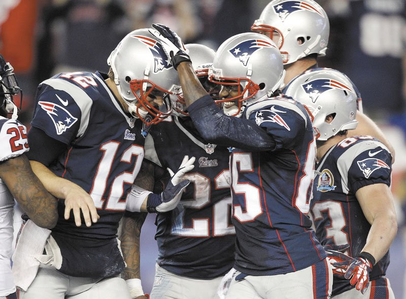 ALL SMILES: New England Patriots wide receiver Brandon Lloyd, right, quarterback Tom Brady celebrate during the Patriots' 42-14 win over the Houston Texans on Monday in Foxborough, Mass.