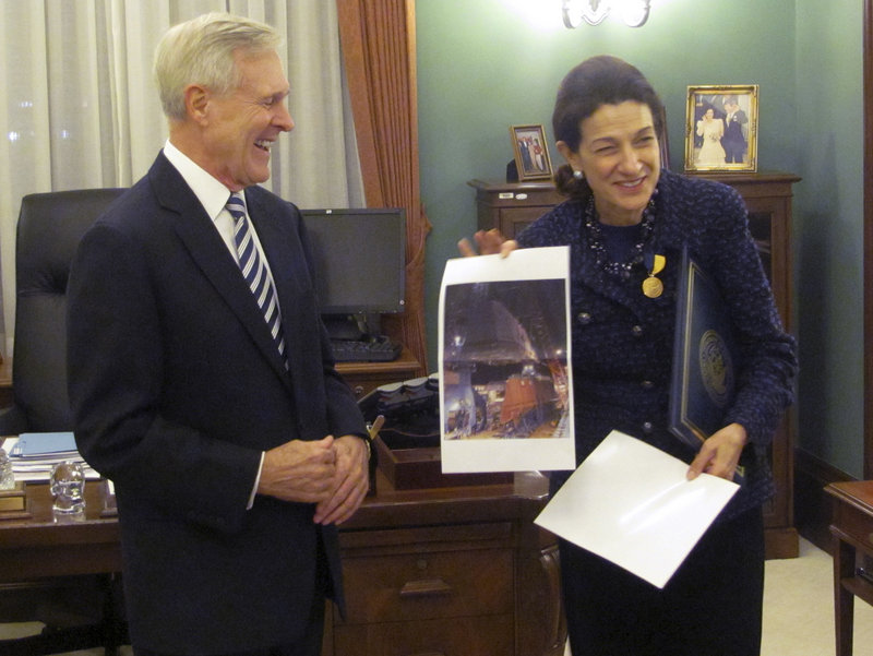 Sen. Snowe shows a picture of the Navy destroyer under construction at Bath Iron Works to Secretary of the Navy Ray Mabus, who presented Snowe with the Navy's Distinguished Public Service Award.