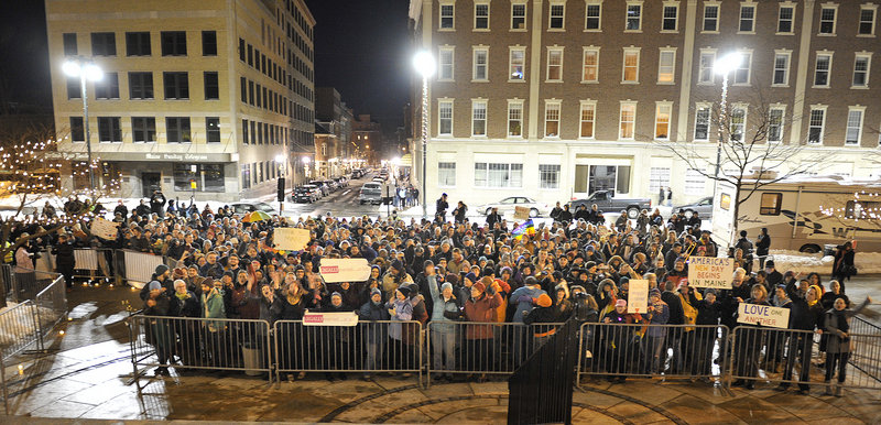 The number of well-wishers outside Portland City Hall ballooned just before midnight and the countdown to 12:01 a.m. Saturday, when same-sex marriage became legal in Maine.