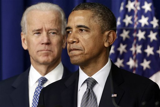 FILE - In this Jan. 16, 2013, file photo, President Barack Obama, accompanied by Vice President Joe Biden, talks about proposals to reduce gun violence at the White House in Washington. Obama has called for a ban on military-style assault weapons and high-capacity ammunition magazines and is pushing other policies in the wake of the mass shooting last month at an elementary school in Newtown, Conn. In response, gun-rights advocates have accused Obama and others of ignoring the Second Amendment rights of Americans. (AP Photo/Charles Dharapak)