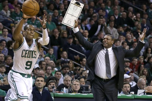 Boston Celtics head coach Doc Rivers, right, gestures for a time out as Boston Celtics point guard Rajon Rondo handles the ball with under a minute left in the second quarter of a game against the New Orleans Hornets on Jan. 16, 2013.