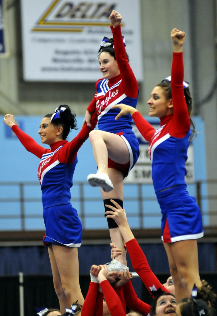 STAND UP: Messalonskee High School cheerleaders compete during the Kennebec Valley Athletic Conference Class A championships Monday in Augusta.