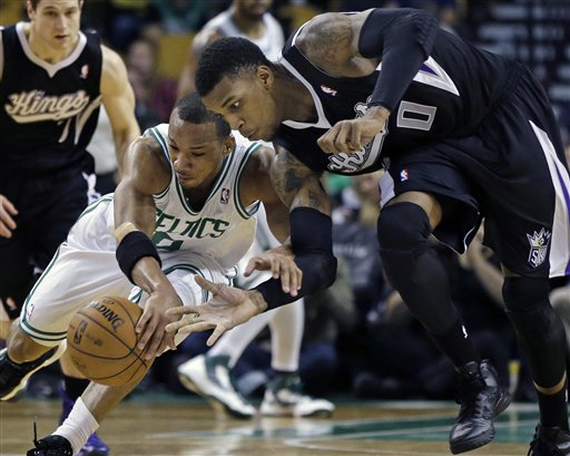 Sacramento Kings power forward Thomas Robinson (0) steals the ball from Boston Celtics point guard Avery Bradley, left, during the second half of an NBA basketball game in Boston, Wednesday, Jan. 30, 2013. The Celtics won 99-81. (AP Photo/Elise Amendola) TD Garden
