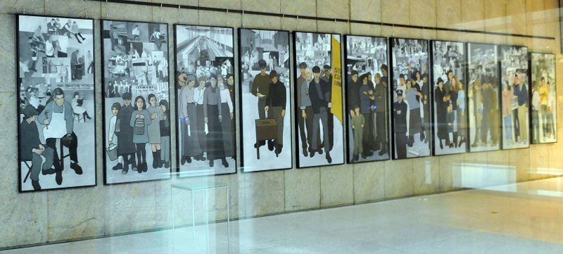 The 11-panel labor mural that Gov. Paul LePage ordered removed in March 2011 from the lobby of the Department of Labor in Augusta is shown at its new home on display in the entrance of the Maine State Museum in Augusta.