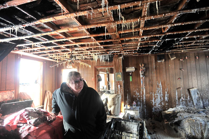 Icicles hang from the ceiling of the living room in Becky Williams' parents' Madison home, which was destroyed by fire around 3 a.m. Friday.
