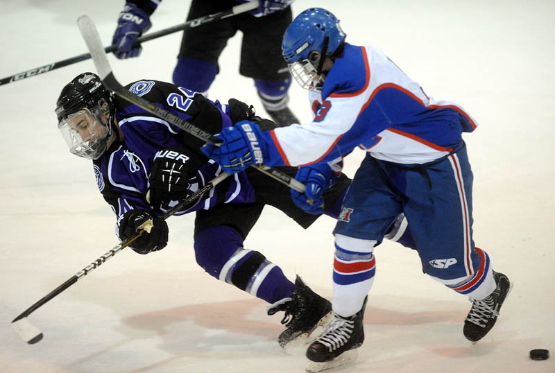 BATTLE FOR THE PUCK: Messalonskee High School's Josh Towle, right, checks Waterville Senior High School's Zach Disch in the first period Wednesday at Sukee Arena in Winslow.