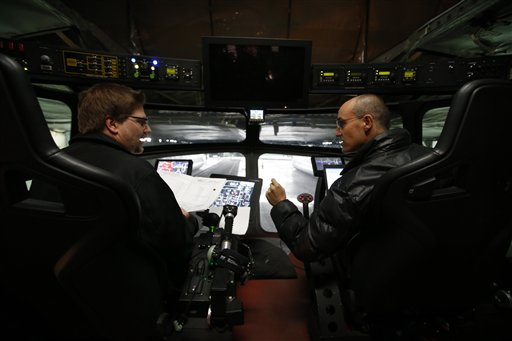 Electrical engineer Varoujan Sarkissuan, left, and aerospace engineer Munir Jojo chat in the cockpit of the Aeroscraft.