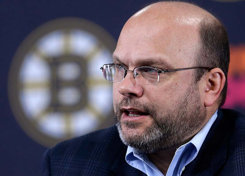 Boston Bruins GM Peter Chiarelli responds to a question from a reporter during a news conference at the TD Garden before Sunday's practice in Boston.