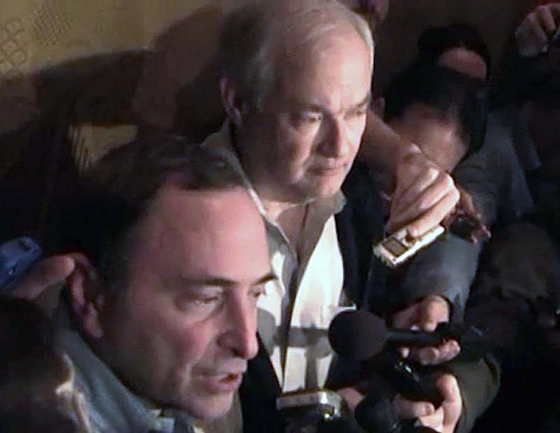 In this image from video, NHL commissioner Gary Bettman, left, talks to the media as Donald Fehr, executive director of the NHL Players' Association, stands next to him, in New York, early Sunday. A tentative deal to end the 113-day NHL lockout was reached early Sunday morning following a marathon 16-hour negotiating session.