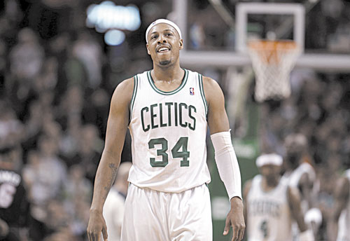 LEADING THE WAY: Boston forward Paul Pierce smiles as the Celtics take the lead in the second overtime against the Miami Heat on Sunday in Boston.
