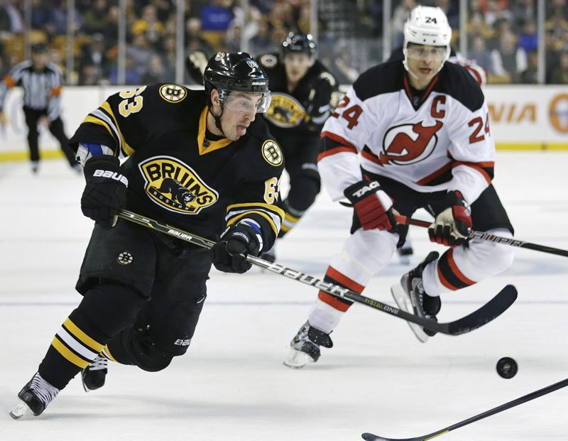 Boston Bruins forward Brad Marchand scored the decisive goal to give the Bruins a 2-1 win over the New Jersey Devils on Tuesday night.