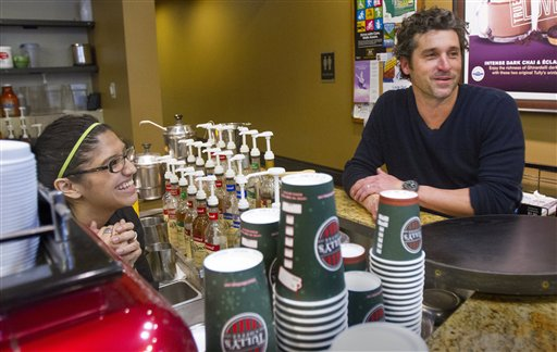 Patrick Dempsey's investment group has won the bid to purchase Tully's Coffee. Dempsey meets the staff at the Tully's Coffee on Western Avenue near the Pike Place Market on Friday, Jan. 4, 2013. (AP Photo/The Seattle Times, Mike Siegel)