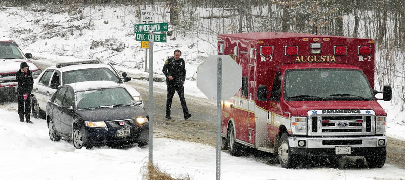 Augusta Police and Fire departments responded to several accidents during the snow storm including this one near corner of Summerhaven Road and Civic Center Drive on Wednesday January 16, 2013.
