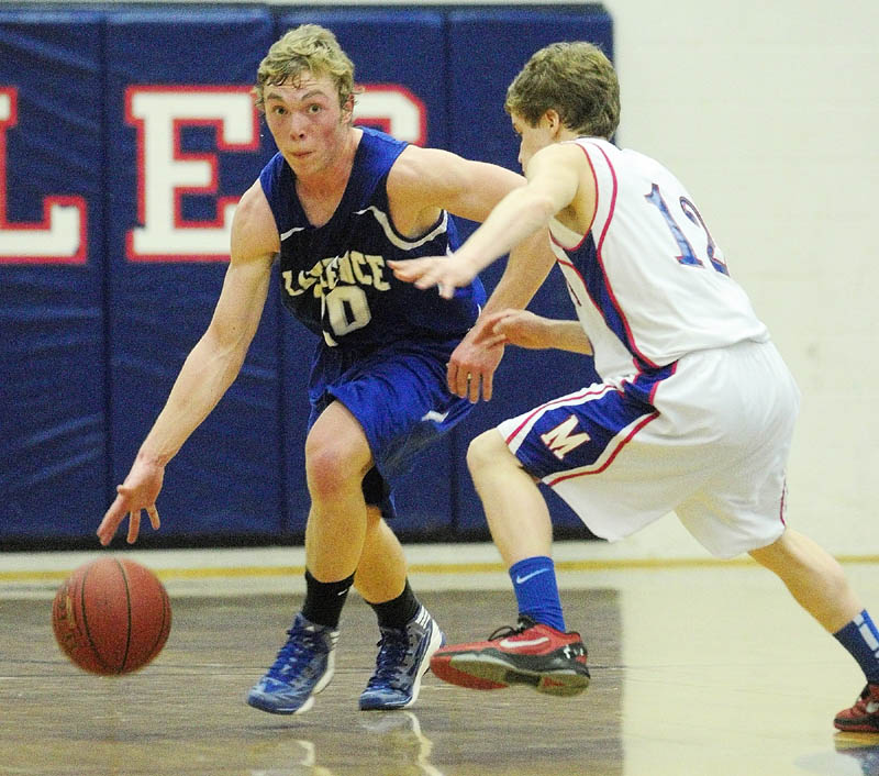 Lawrence's Matt Saunders, left, tries to dribble around Messalonskee's Quinn Warren during a game on Friday night at Messalonskee High School.