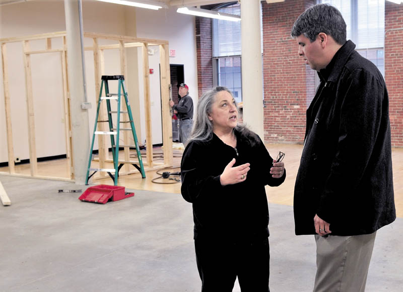 Maureen Hibler speaks with Thomas McCowan inside her Button Down Cafe, being constructed inside the Hathaway Creative Center in Waterville, on Thursday.