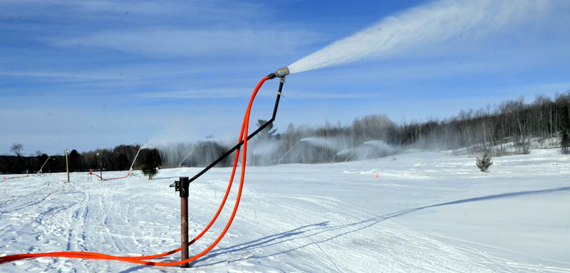 New snow-making equipment is being put to work covering trails for skiers at the Quarry Road Recreation Area in Waterville.