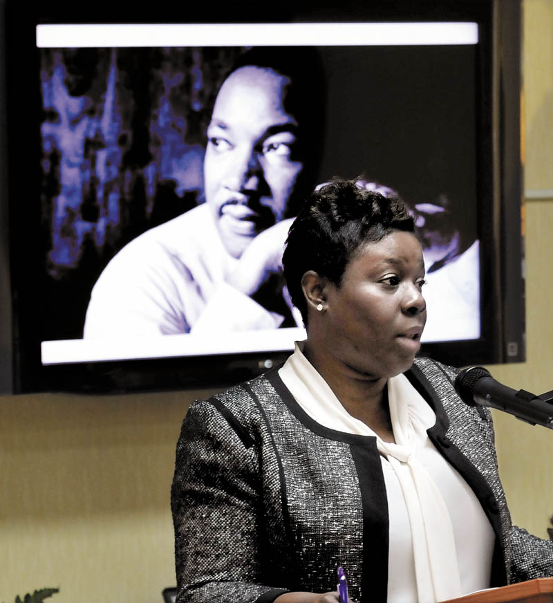 Tashia Bradley gives the keynote address during the 27th annual Martin Luther King Jr. Day community breakfast at the Spectrum Generations Muskie Center in Waterville on Monday.