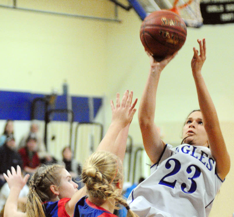 Messalonskee's Taylor Easler, left, and Mikayla Turner try to stop Erskine's Bridget Humphrey during a game on Friday at Erskine Academy.