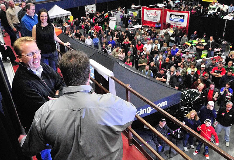 Ricky Craven, left, talks with show promoter Steve Perry after being introduced as one of the Top 25 people in regional racing during the Northeast Motorsports Show on Friday at the Augusta Civic Center.