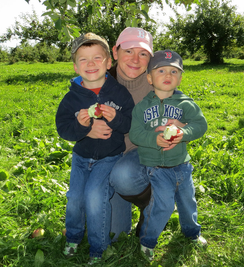Angie Horler, center, is pictured with her two sons, who were both with her when her truck collided with a Toyota Corolla in Raymond on Thursday night. Everyone involved in the violent crash survived.