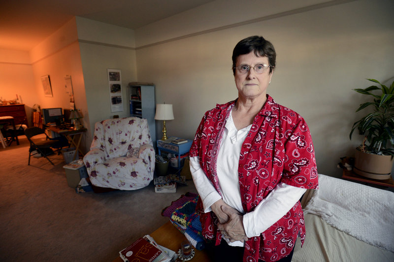 Shirley Jackson, 68, seen Thursday in her South Berwick apartment, says she can no longer earn money other than her Social Security income or she will be dropped from Medicaid rolls because of financial eligibility requirements. She says while she feels lucky compared to others who will be cut, her income leaves little room for even modest extra spending.